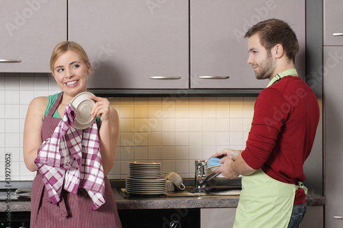 A young couple washing together