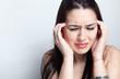 Headache concept - woman suffering a migraine