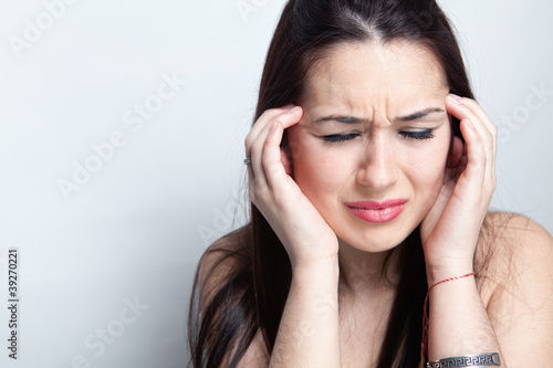 Headache concept - woman suffering a migraine