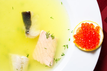 Fish soup with lemon and red caviar