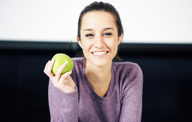 portrait of a beautiful young woman with green apple