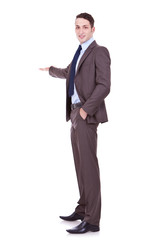 Full length of successful business man presenting