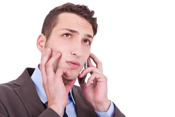 contemplative businessman talking on phone