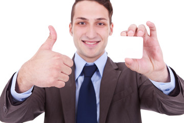 man showing a blank business card