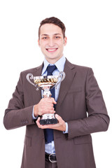 winning businessman holding his award