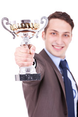 business man handing a trophy