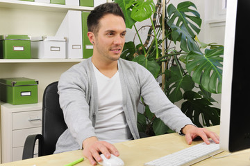green office: businessman working