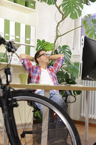 green office: businessman with bicycle at office