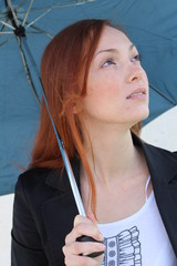 A beautiful woman with an umbrella, looking up