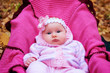 Beautiful girl in a pink baby clothes