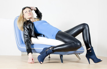 woman wearing fashionable shoes lying on sofa