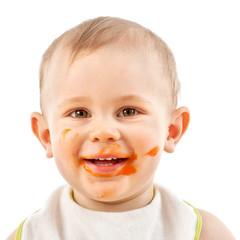 Baby mit Karottenbrei