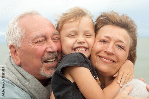 happy grandparents with grandchild