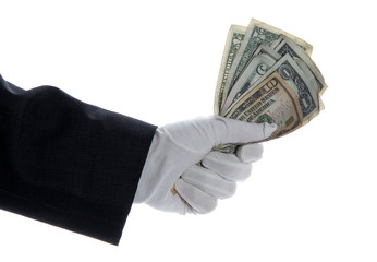 hand with glove holding bunch of dollars