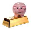 gold bullion with pink piggy bank