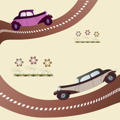 two vintage cars on the road