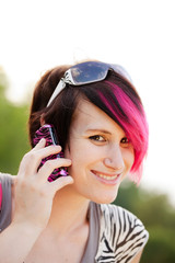 Punk woman on a cell phone