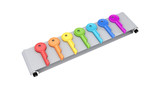 Colorful keys on grey conveyor.