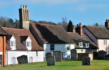 Old english village graveyard and cottages