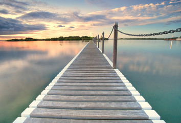 pontoon jetty across the water © clearviewstock