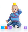 Funny little child is playing with cup toys, isolated over white