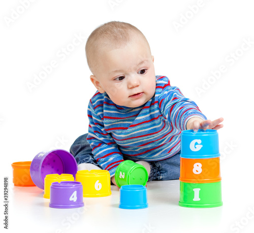 baby is playing with educational toys, isolated over white