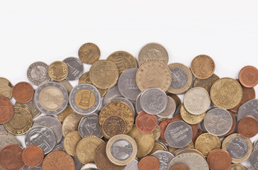 Background with different coins close-up on white background