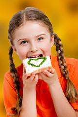 Lovely girl eating spring sandwich