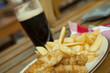 Fish and chips with dark beer