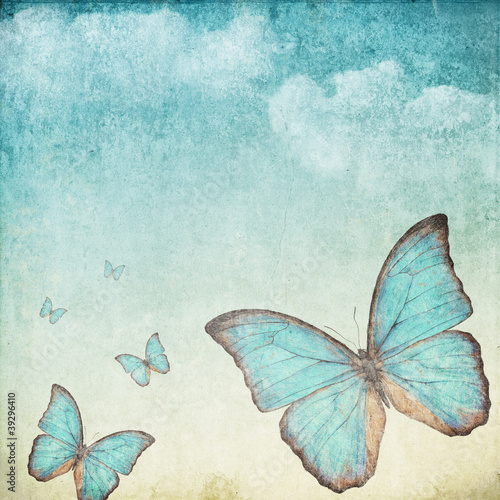 Vintage background with a blue butterfly © determined