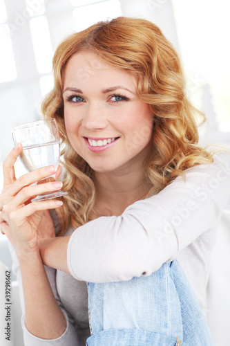 Portrait of woman drinking water