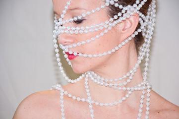 Enredada en perlas