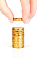 Finger put coins on coin-stack