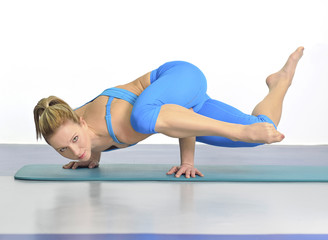 Woman in yoga pose standing on her hands
