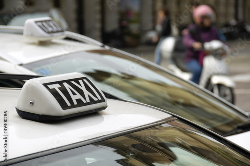 Taxi sign on an urban cab