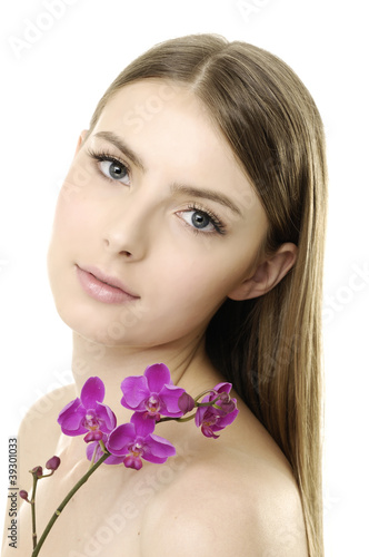 pretty woman with beautiful makeup holding violet orchid