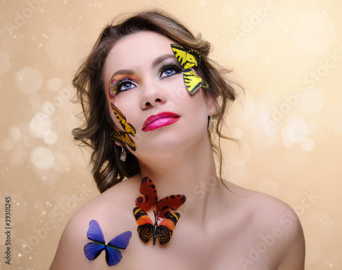 fashion woman with professional make-up,butterflyies
