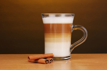 Fragrant сappuccino latte in glass cup and cinnamon
