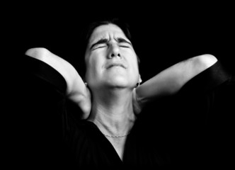 Black and white portrait of a stressed woman