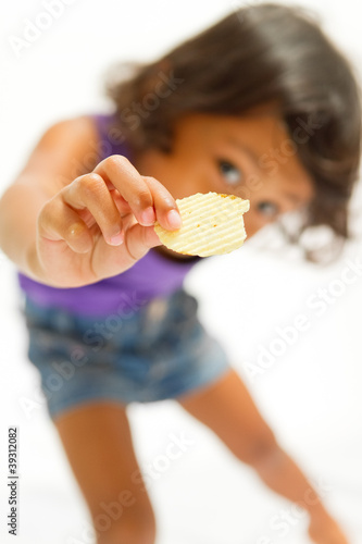 happy ethnic child with snack on hand