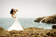 Bride in front of the sea
