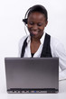 Woman with telephone headset and a laptop
