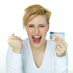 Young woman is so happy getting a driver licence