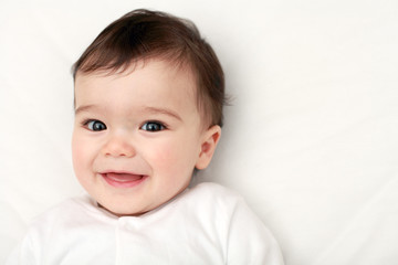 Gorgeous baby smiling to camera