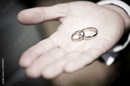 Hand holding wedding rings