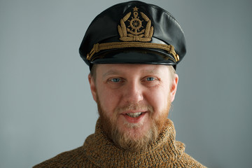Smiling, bearded captain