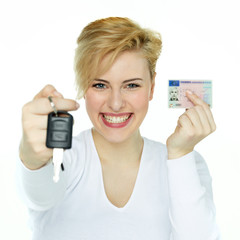 Young woman showing her driver licence and carkey