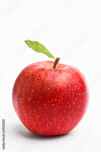Red apple with a leaf