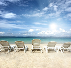 chairs on beach with blue sky for summer holiday