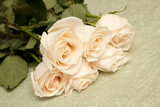 White rose bouquet isolated on green tablecloth